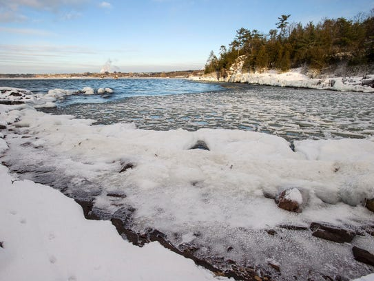 Ice begins to form in a cove at Oakledge Park in Burlington