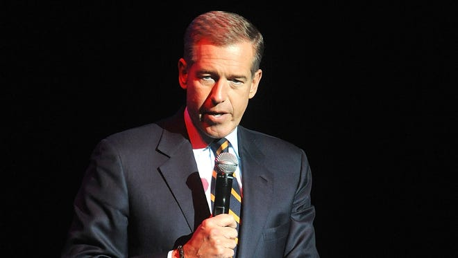 """FILE - In this Nov. 5, 2014 file photo, Brian Williams speaks at the 8th Annual Stand Up For Heroes, presented by New York Comedy Festival and The Bob Woodruff Foundation in New York. Williams is backing out of scheduled appearance on David Letterman's """"Late Show"""" on Thursday.That news from NBC came Sunday, a day after Williams said he was stepping away from NBC's """"Nightly News"""" as the network looks into the anchor's admission that he had told a false story about being on helicopter hit by a grenade while reporting on the Iraq war. (Photo by Brad Barket/Invision/AP, File)"""