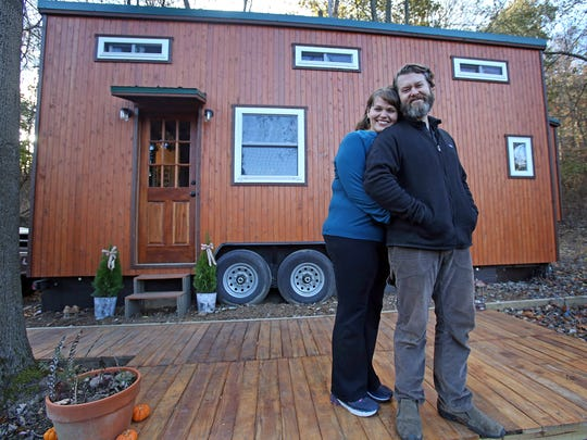 Malcolm Smith and his girlfriend Nina Bacardi are photographed in front of their Tiny Home in Rockland Nov. 20, 2017.