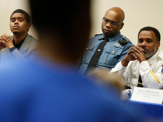 """Panelists (from left) citizen Keith James, Delaware State Police Cpl. Richard Collins and Wilmington Police Captain Faheem Akil listen to an audience member during the """"Pullover Etiquette"""" forum with public and police representatives Saturday in Wilmington."""