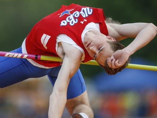 Logan Benson, of Western Boone, wins high jump with
