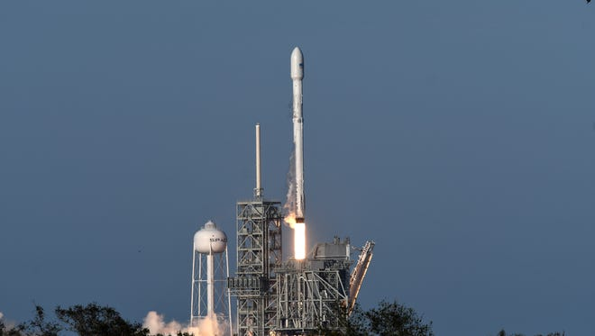 A SpaceX Falcon 9 rocket lifts off from pad 39A at Kennedy Space Center Thursday, March 30, 2017.  The rocket, carrying a commercial communications satellite marks the first time SpaceX has reused one of its Falcon 9 boosters.