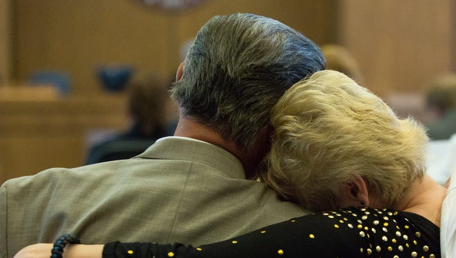Linda Martin-West, the mother of the victim Jeremy Martin,  leans her head on the shoulder of her husband Jim West on Thursday, May 26, 2016, as an audio recording plays during the Tai Chan murder trial at 3rd Judicial District Court.