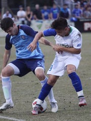 FGCU's Dylan Sacramento and NYCFC's Andoni Iraola battle for possession during an exhibition game at the FGCU soccer complex on Sunday.