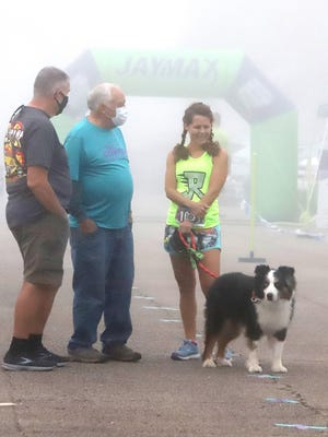 Kent Kirchner, from left, Larry Price and Janet Cantwell spend a few minutes talking before the start of the Teal Stampede 5K and 10K Run and Fun Walk, Saturday, Sept. 26, at Chaffee Crossing, benefiting The River Valley Ovarian Cancer Alliance and the Leukemia & Lymphoma Society.