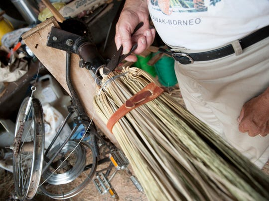 Sam Moyer of Mount Laurel crafts a broom in a workspace