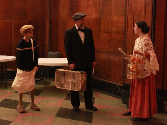 Calvin Pettigrew, Randy Kendrick and Abigail Neel play ghosts Friday at the New Southern building during the annual Downtown Ghosts-A-Walking Tour.
