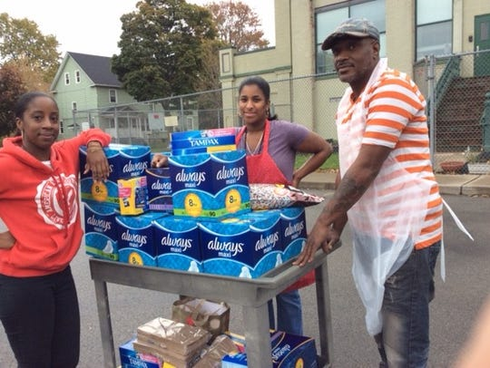 Volunteers bring in supplies for a P.A.D. Project kit