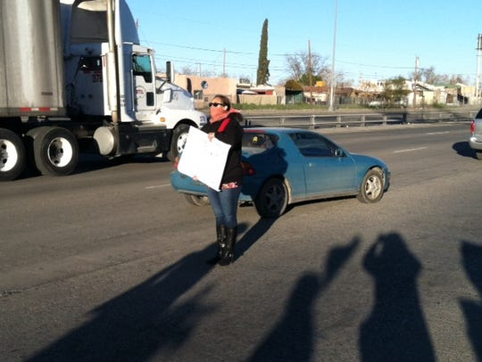 A protester tries to block the path of border truck