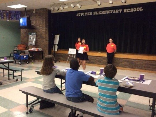 The Project Table Etiquette team leads a presentation on manners at Jupiter Elementary School