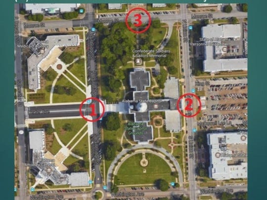 A suspect is in custody after spray painted terrorist threats were found around the Statee Capitol and two other locations.