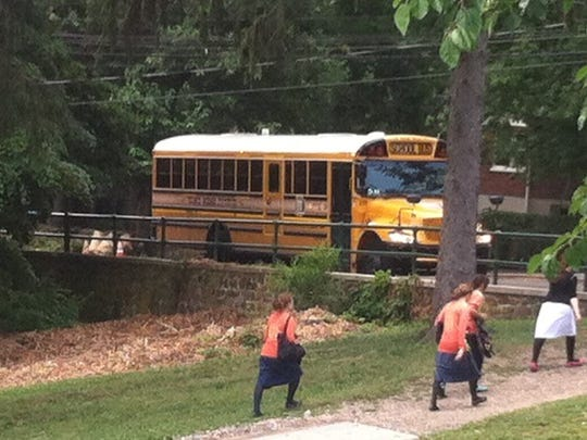 Day campers return to buses parked on Piermont Avenue