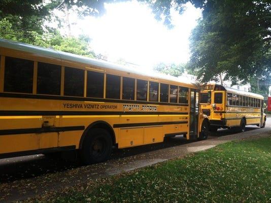 636667363836747568-buses.mark.dery.070518.jpg