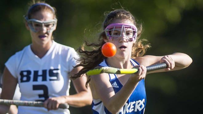 Colchester's Katina Messier eyes the ball against Burlington at Orrie Jay Field on Friday afternoon.