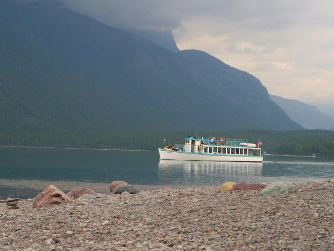 1. Explore Glacier National Park by foot, by boat and by red bus.