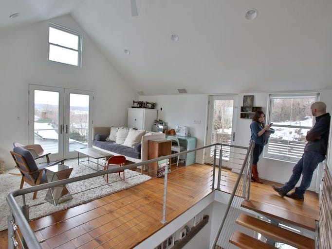 Ricky Restiano and Catherine Holland in the top-floor living room of their Piermont home Jan. 28, 2014. ( Peter Carr / The Journal News )
