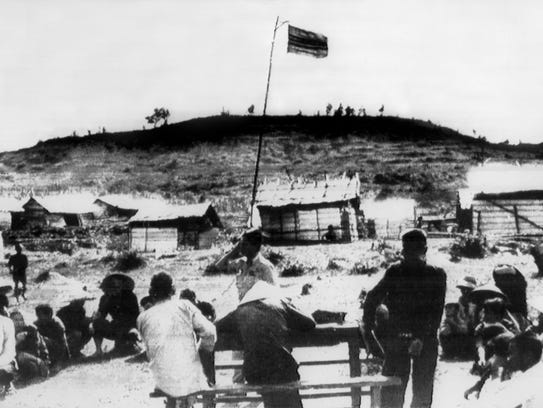 The Vietnamese flag flies over the village of My Lai