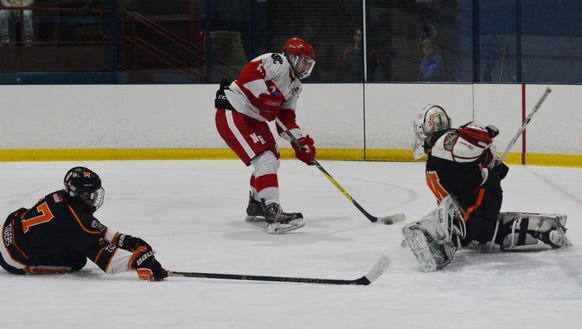 Mamaroneck goalie Jack Fried makes one of his 29 saves
