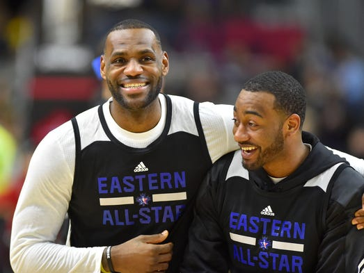 LeBron James jokes with John Wall during practice on