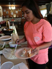 Mariana Diaz prepares dinner in her family's Southern