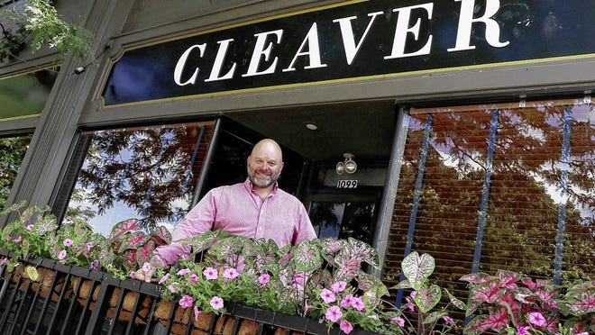 Tony Tanner stands next to the sign at Cleaver, a restaurant he has opened with Matt Evans (not pictured) at 1099 W. First Ave. in Grandview Heights.