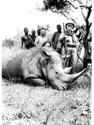 George Eastman poses with a white rhino he bagged on a 1926 or 1928  East Africa safari.