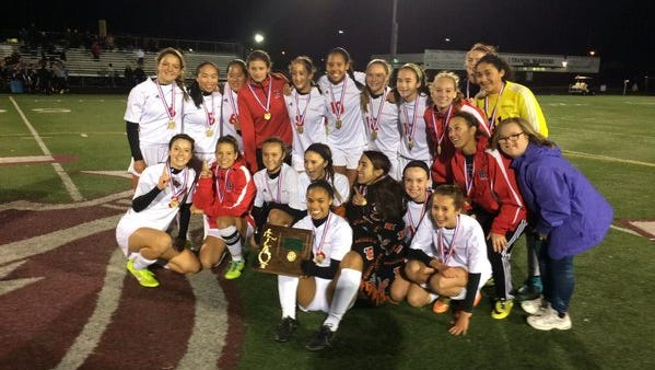 Indian Hill's girls' soccer team celebrates its Division II district title Oct. 29 after a 5-0 defeat of Shawnee.