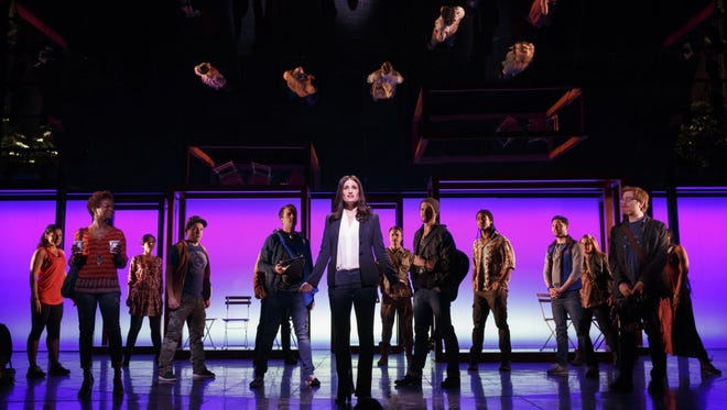 """This image released by Polk and Co. shows Idina Menzel, center, with the cast during a performance of """"If/Then,"""" at the Richard Rodgers Theatre in New York. Menzel is nominated for a Tony Award for best performance by an actress in a leading role in a musical."""