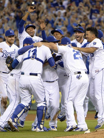 Royals players celebrate winning the American League