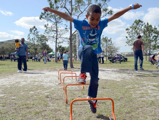 Five-year-old Rocco Mingo jumps obstacles during Get