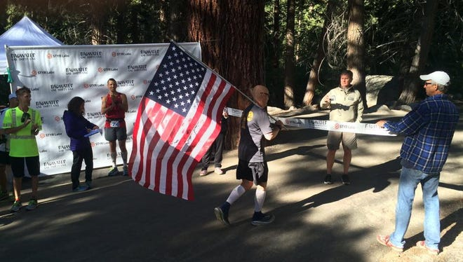 After running 135 miles in 34 hours and 22 minutes, Rochester police sergeant and Orleans County resident Brett Sobieraski completes the Badwater ultramarathon in California on July 20, 2016.