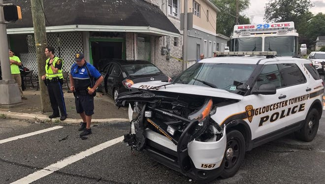 Gloucester Township police investigate a crash involving one of their own vehicles Friday night at Black Horse Pike and Station Avenue.