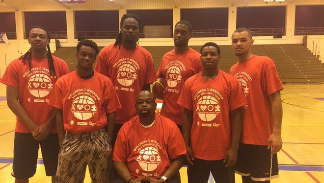 Dell Williams with some of the boys he mentors and coaches