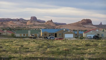 The Navajo Nation's embattled housing agency is set to get a new, smaller and more qualified board of commissioners under reform legislation signed by President Russell Begaye.  Here, brightly colored roofs highlight new homes built for Navajos in Kayenta. The Navajo Housing Authority exists to provide homes on the impoverished reservation.
