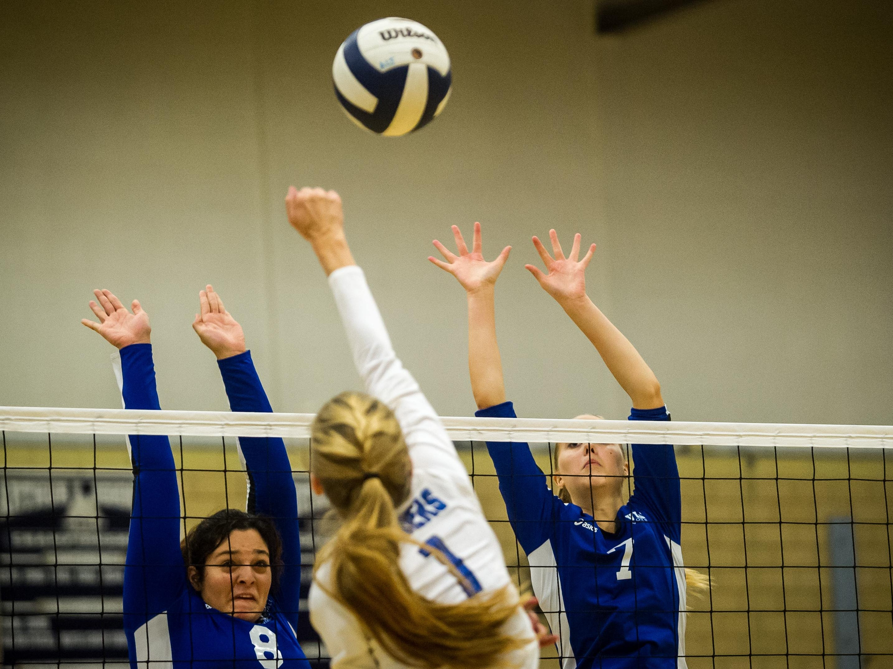 Union Catholic's Anna Bella Giacobbe (left) and Julia Hayes go up to block Scotch Plains-Fanwood's Callen Leahy return in the Union County Tournament semifinals on Wednesday at A.L. Johnson High School.