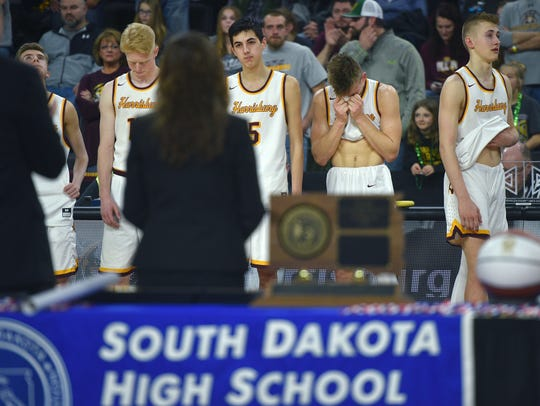 Harrisburg teammates react after their lose to Yankton