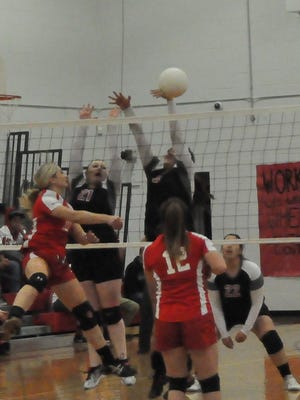 The Corona Lady Cardinals overcame the Carrizozo Lady Grizzlies 3-0 in the Class 1A District 3 volleyball championship Nov. 5.
