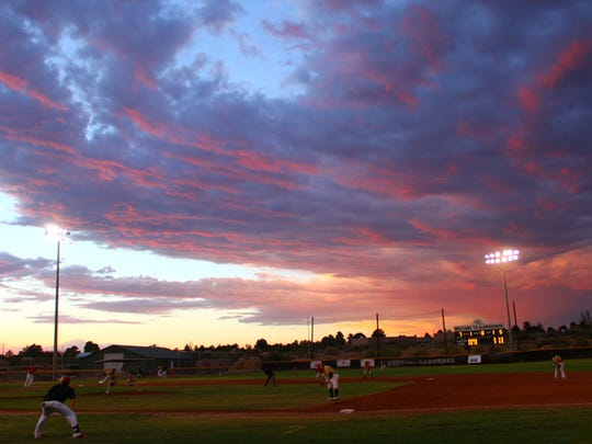 The sun sets at the Griggs Sports Complex on Thursday night.