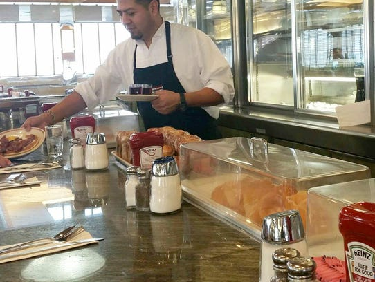 Tick Tock Diner employee Gerardo Tochimani.  Tick Tock