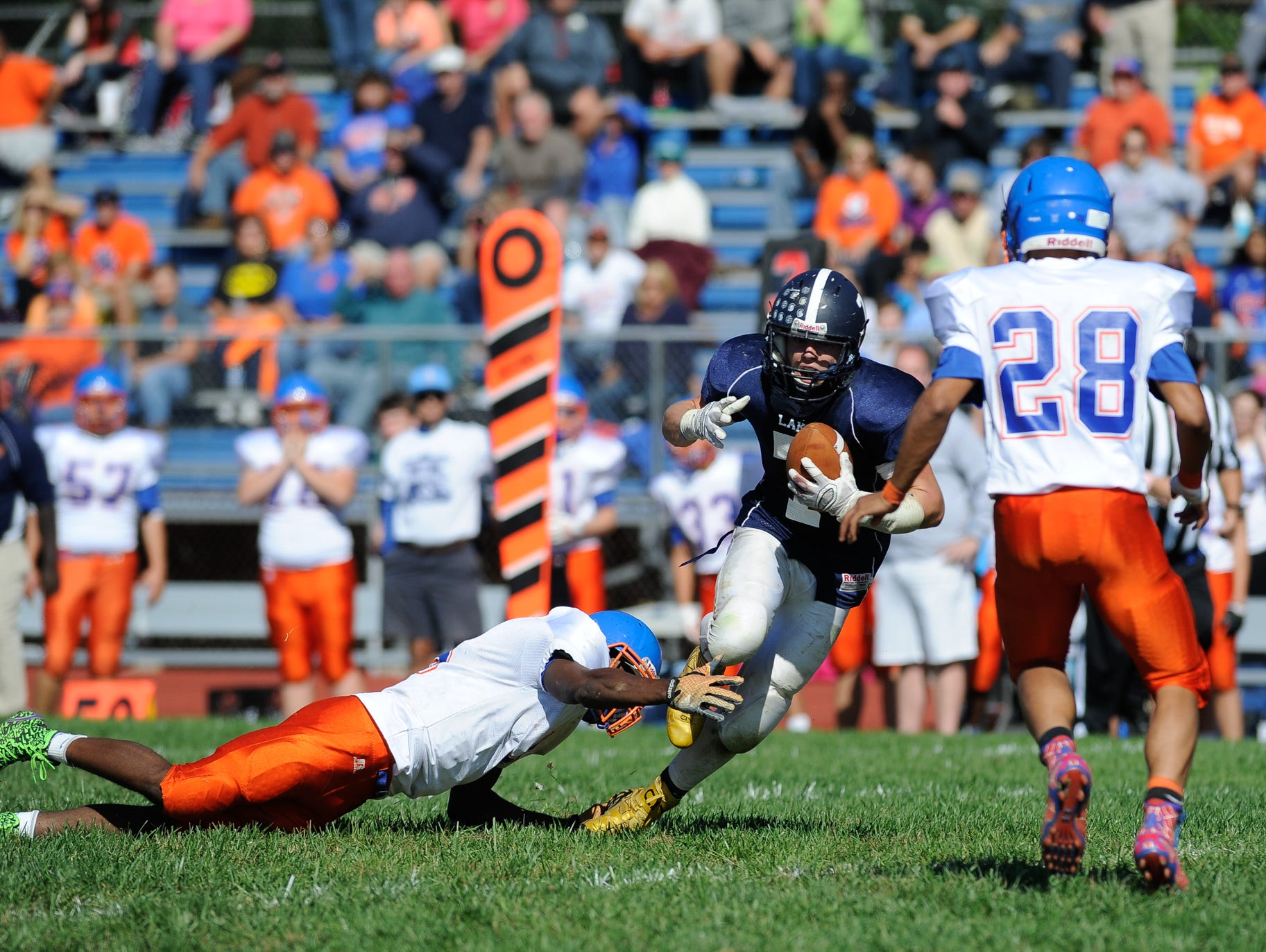 Lake Forest's #7 Ben Moore runs the ball down field in their 19-14 win over Delmar on Saturday at Lake Forest High School.
