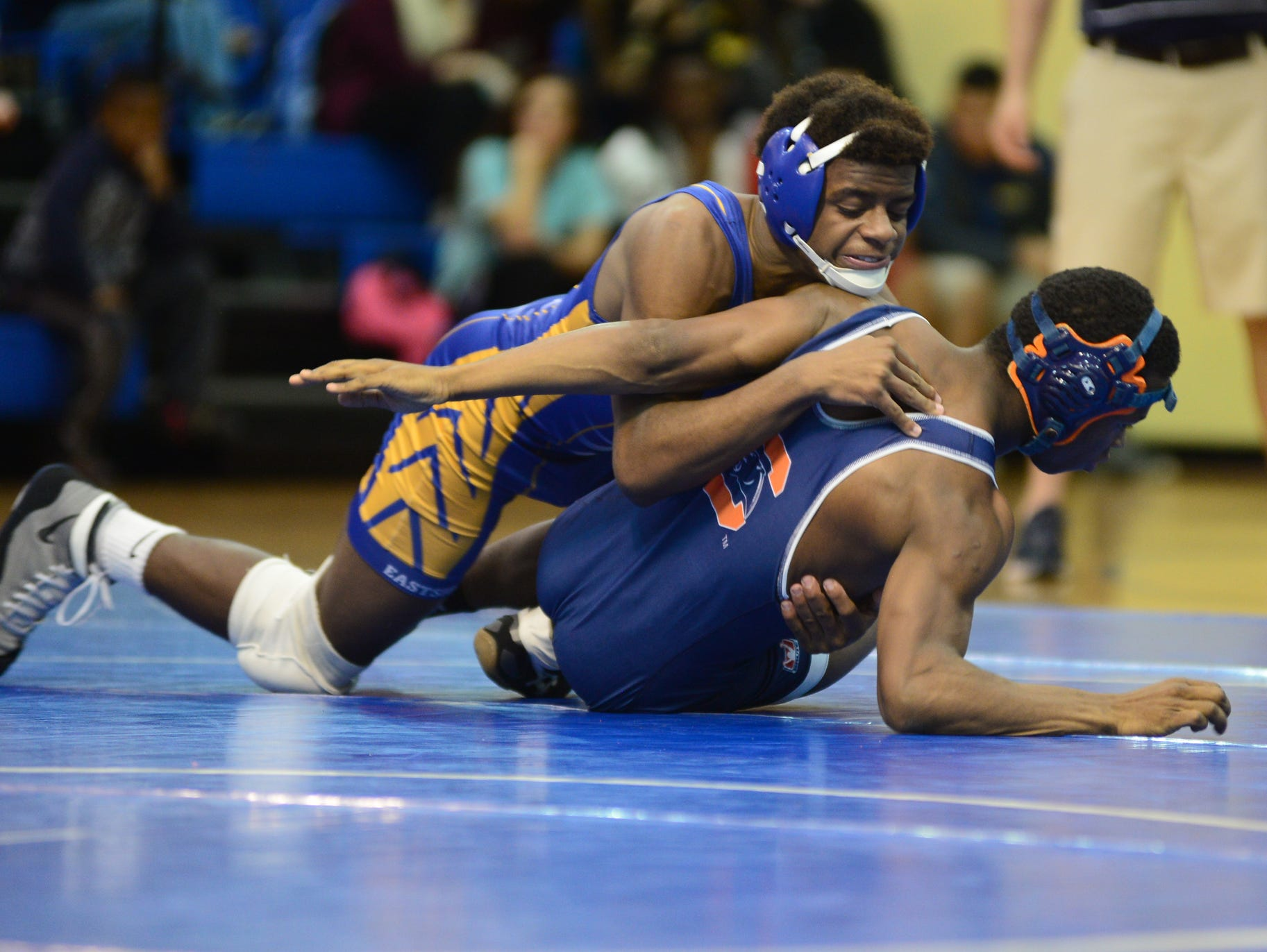 Eastside High's Chance Pride goes up against Qualin Mack-Nesbitt of Chapman during a wrestling match at Eastside Wednesday afternoon.