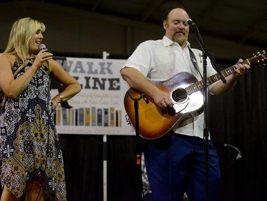 "Kellye Cash Sheppard performs ""Jackson"" next to her"