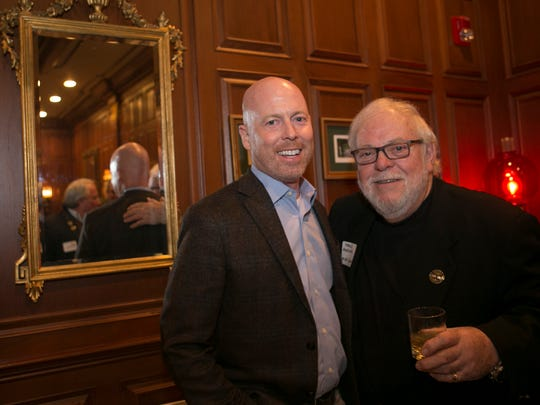Outgoing Grand Marshal John Hyland of Morristown, with this year's Grand Marshal, T. Michael Quinn of Chester. Participants and sponsors of the St. PatrickÕs Day Parade are honored at a reception in the mahogany room in the Grand CafŽ,  Morristown, NJ. Wednesday, Feb. 15, 2017. Special to NJ Press Media/Karen Mancinelli/Daily RecordMOR 0217 St Patricks Grand CafŽ