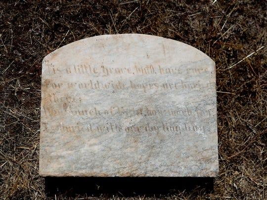 The back of the headstone recently returned to Parkville
