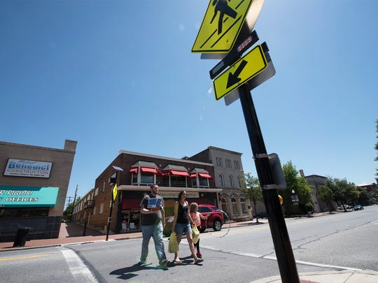 Pedestrians cross Main Street on Tuesday, June 12, 2018 in Waynesboro. The Borough of Waynesboro plans to spend an estimated $800,000 to make its downtown street safer for pedestrians.