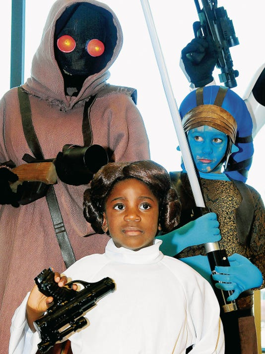The Turnbow family, including Gisele as Princess Leia, Leslie as Jawa and Caitlin as Aalya Secura, gather during a recent Star Wars Reads Day at Barnes & Noble in the Mesilla Valley Mall. Events celebrating Star Wars, Minions, Dr. Seuss and new books, movies and the styles of decades from the 1950s to the 1990s will be held at the Mesilla Valley Mall bookstore throughout July.