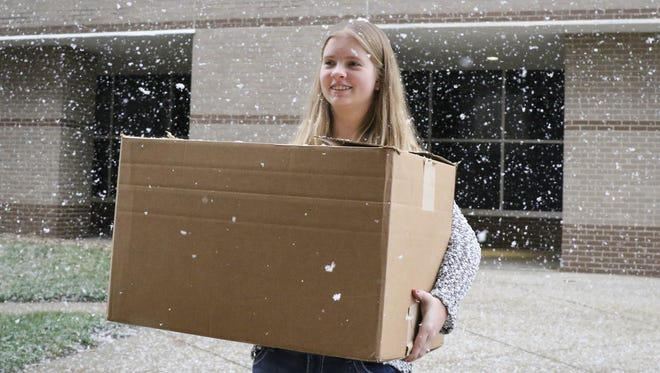 Grace Braun, 14, a freshman at Algona High School, makes a Christmas Eve delivery of 50 handmade blankets to Blank Children's Hospital Thursday Dec. 24, 2015.