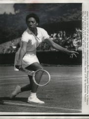 In this 1958 file photo, Althea Gibson of New York is shown defeating Valeria White of England in the Wimbledon quarter finals.