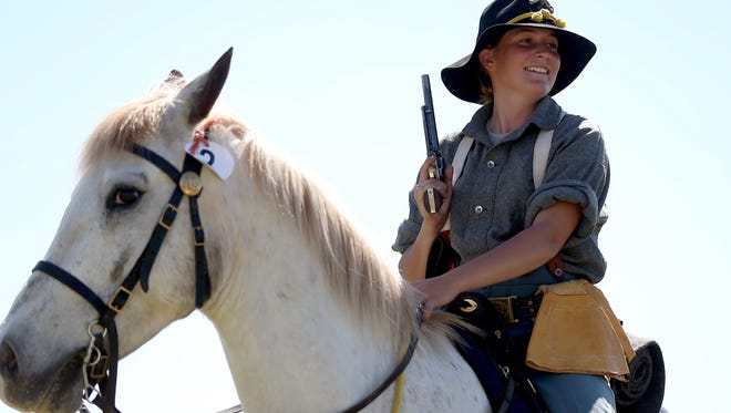 Courtney De Long prepares to make her pistol run during the Regional Cavalry Competition at Fort Concho National Historic Landmark in 2016.