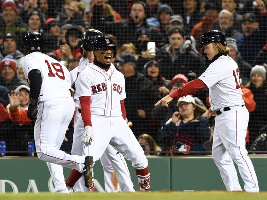 Apr 10, 2018; Boston, MA, USA; Boston Red Sox right fielder Mookie Betts (50) reacts with short stop Brock Holt (12) after hitting a grand slam during the sixth inning against the New York Yankees at Fenway Park.